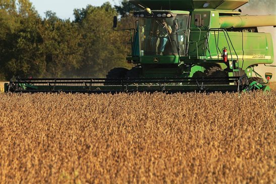 Farmers harvesting soybeans in rural Sangamon County.  A bill proposed in Springfield would require farming equipment manufacturers like Illinois-based John Deere to sell diagnostic software and replacement parts directly to farmers so they can fix their equipment on their own. AP Photo/Seth Perlman