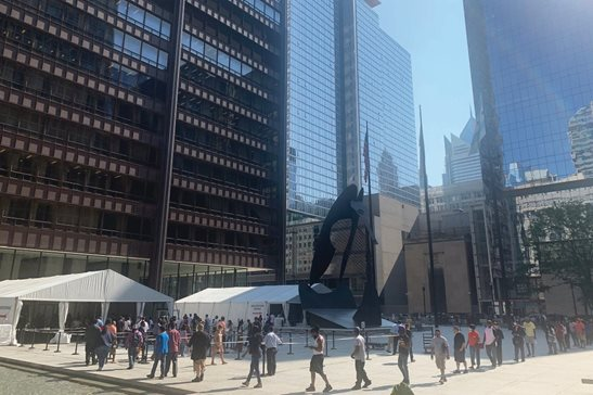 Lines to enter the Daley Center snake across Daley Plaza on July 7 as members of the public face additional screening to prevent the spread of COVID-19. The circuit court is using Zoom videoconferencing in many matters to limit the crowds inside court facilities.