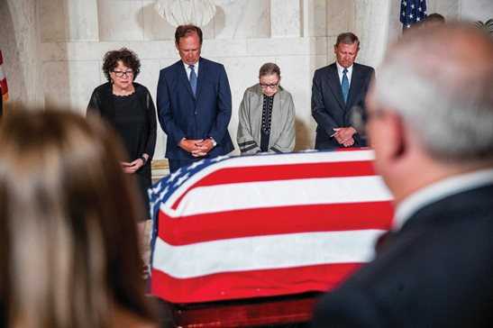 From left, Associate Justice Sonia Sotomayor, Associate Justice Samuel Alito, Associate Justice Ruth Bader Ginsburg, and Chief Justice John Roberts participate in a moment of silence during a private ceremony in the Great Hall of the Supreme Court in Washington on Monday morning, where the late Supreme Court Justice John Paul Stevens lies in repose.