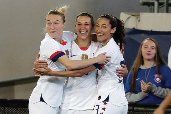 U.S. forward Carli Lloyd (center) celebrates her goal against Costa Rica with Emily Sonnett (left) and Christen Press during an international friendly soccer match Sunday in Jacksonville, Fla. A federal judge in Los Angeles on Friday ruled to expand the equal-pay case beyond the initial 28 plaintiff players to include all players called up to camp or who played in a game over a multiyear period.