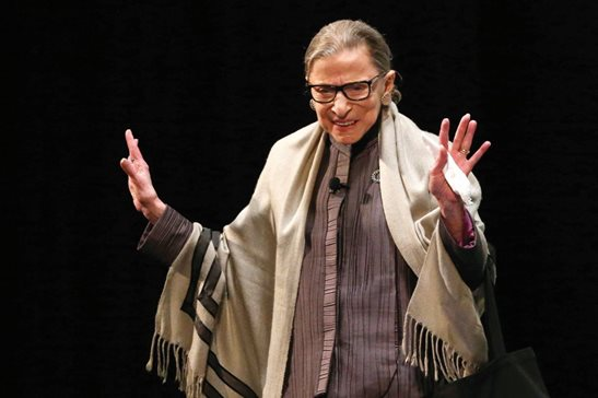 U.S. Supreme Court Justice Ruth Bader Ginsburg acknowledges applause at Roosevelt University's Auditorium Theater in 2017. Ginsburg died of metastatic pancreatic cancer at age 87 on Friday.
